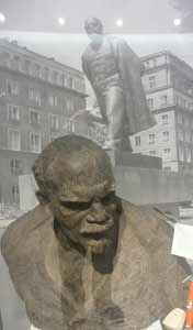 Lenin bust and a photo of the Lenin statue that was removed from Central Square in December 1989