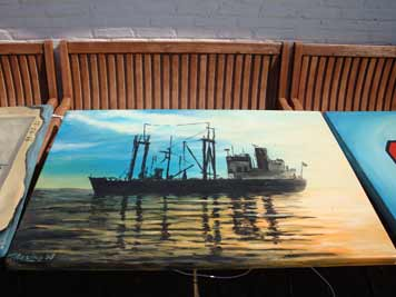 Painting of the OKA on a terrace table outside the famous bar