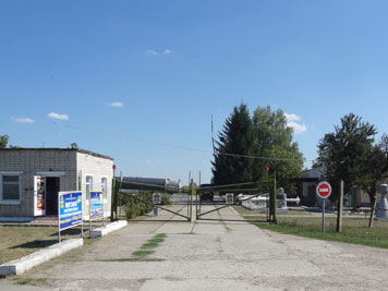 Entrance of the former Pervomaysk missile base with original guard house and gate