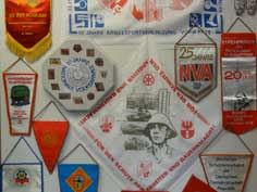 Collection of GDR memorial banners celebrating the 25th anniversary of the army and the 20th anniversary of the GDR