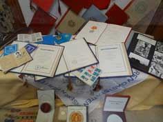 Varity of GDR documents including a passports and charters that were awarded for outstanding socialist activities