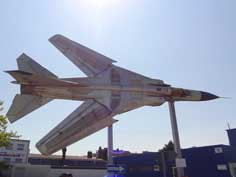 A MiG-23ML from the East German Air Force displayed side ways on the entrance of the Auto & Technik Museum Sinsheim