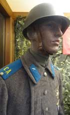 Soviet Air Force soldier with blue felt collar tabs on gold with para device and blue felt shoulder boards with yellow CA