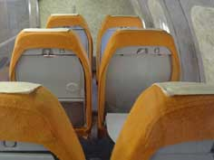 The orange seats of the Tu-144 that were never occupied during an actual passenger flight