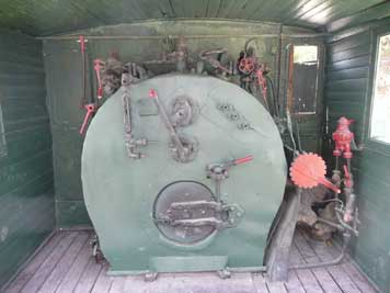 Interior of the Ov 1534 steam locomotive with pressure gauges and the door to the fire box