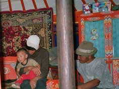 Visiting of a nomad family somewhere on the plains of Mongolia